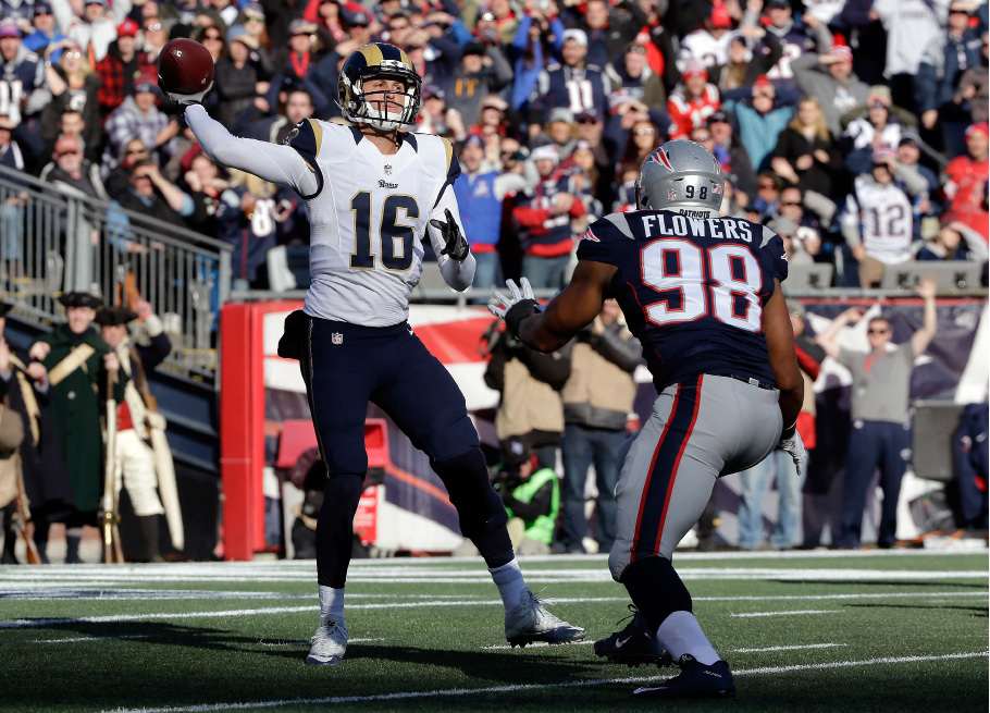 Los Angeles Rams quarterback Jared Goff (16) passes against the rush by New England Patriots defensive lineman Trey Flowers (98) during the first half of an NFL football game, Sunday, Dec. 4, 2016, in Foxborough, Mass. (AP Photo/Steven Senne)