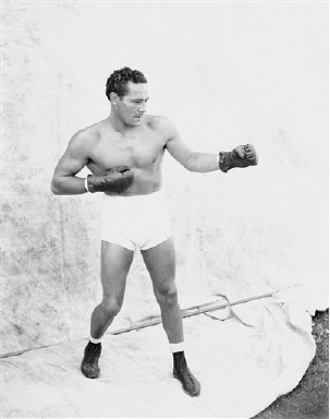 Max Baer in a fighting pose  Sept. 21, 1935 as he tapered off his training at Speculator, N.Y.   Baer will face  Joe Louis in the Yankee Stadium in New York, on Sept. 24, 1935.   (AP Photo)