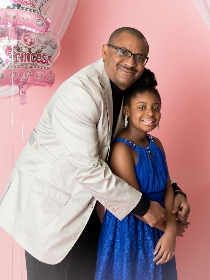 Fourth-grader Brianna Albert with her dad, Wilkens Albert.Photos by Clicky Chicky Photography
