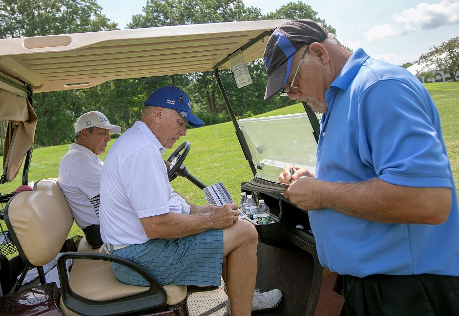 Left to right, Jose Diaz, of Florida, Les Zimmerman, of Meriden and Kevin Grobsky, of Meriden, add up their scores after the first round of the Meriden Golf Senior Championship at Hunter Golf Club in Meriden, Wed., Aug. 7, 2019. Zimmerman, a six-time Meriden Senior champion and 12-time Meriden Open champ, shot a career-low 67. Grobsky carded a 69 that included four birdies. Dave Zajac, Record-Journal