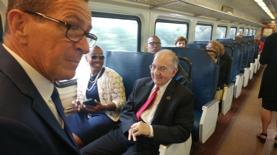 Gov. Dannel Malloy looks over out the window of the CTrail car Friday as Martin Looney, President Pro Tempore of the state Senate, shares a laugh with state Rep. Robyn Porter D-New Haven.
