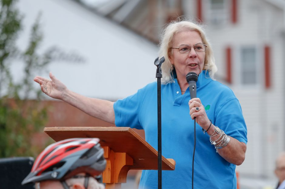 Patti Flynn-Harris welcomes guests to the opening Sunday during a Ribbon Cutting Ceremony for the Farmington Canal Heritage Trail on West Main in Cheshire September 9, 2018 | Justin Weekes / Special to the Record-Journal