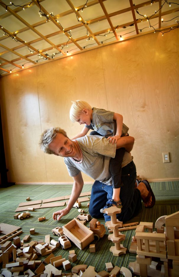 Middletown residents Jon Schroth and his son Asher, 4, play in the block room at Kidcity on Tuesday, May 22, 2018. The children