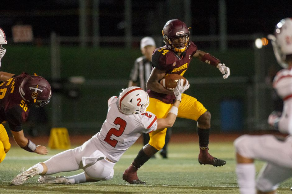 Sheehan's Terrence Bogan has been the area's rushing leader all season. On Friday night against Branford, the junior running back exploded for 406 yards and eight touchdowns to fuel a 50-point swing that turned a 27-14 halftime deficit into a 64-27 Sheehan win. | Justin Weekes / Special to the Record-Journal