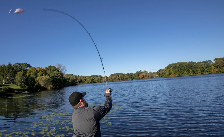 Stephen Justice, of Meriden, casts a line Friday into Beaver Pond in Meriden. Foliage is running about two weeks later than normal in Connecticut according to Christopher Martin, state forester for the Connecticut Department of Energy and Environmental Protection. Dave Zajac, Record-Journal