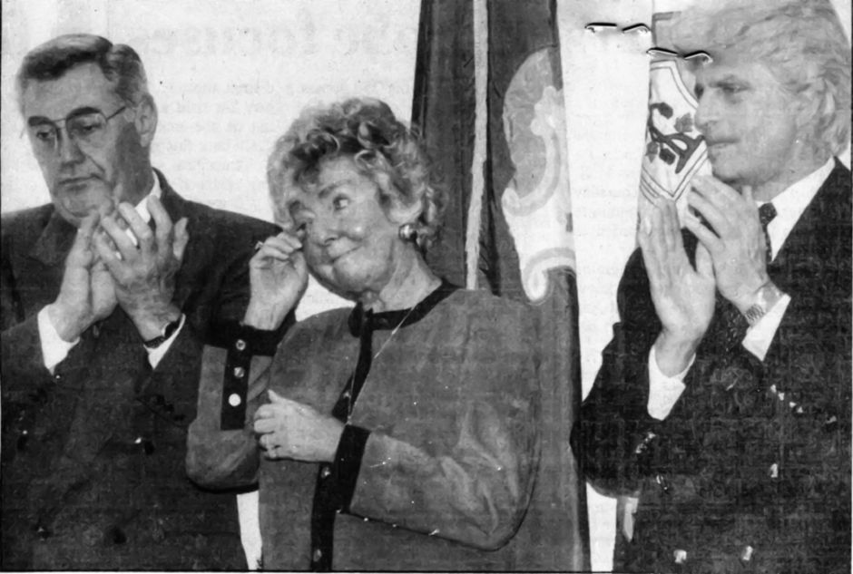 RJ file photo - Amelia Mustone sheds a tear as State Senate President Pro Tem John B. Larson notes her accomplishments May 5, 1994. Flanking Mustone are Patsy Papandrea of the Democratic State Central Committee and Mustone