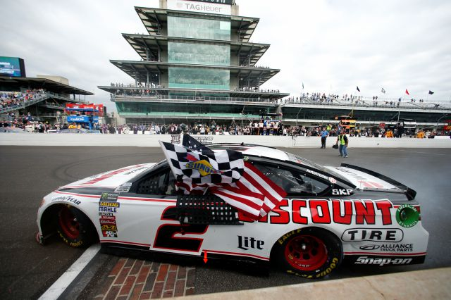 Brad Keselowski (2) celebrates after winning the NASCAR Brickyard 400 auto race at Indianapolis Motor Speedway in Indianapolis, Monday, Sept. 10, 2018. (AP Photo/Rob Baker)
