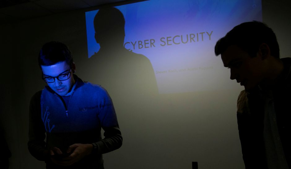 Quinnipiac University computer information systems students Vincent Deriu, left, and Austin Kuppek prepare for a cyber security workshop at Wallingford Senior Center, Wednesday, Nov. 29, 2017. Dave Zajac, Record-Journal