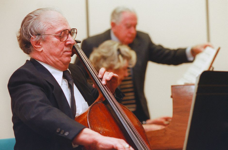 RJ file photo - Cellist Andrew Salvo of East Haven, left and Pianist Elly Zimerman, seated, of Meriden, play a selection at the Meriden Public Library Jan. 10, 1999.