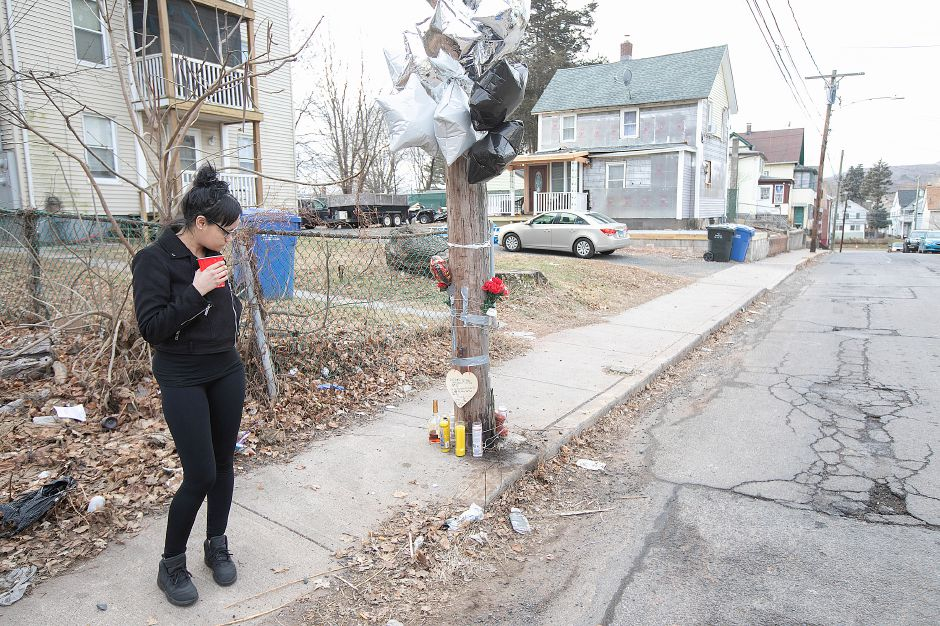 Yaricely Zenquis, of Meriden, reflects at a memorial for friend Aaron Joseph Ormsby, 21, on Foster Street in Meriden, Fri., Jan. 18, 2019. Ormsby was shot and killed in back of 130 Foster St., Thursday night. Dave Zajac, Record-Journal