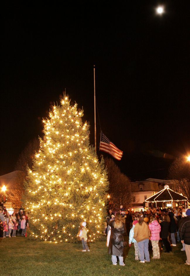 With the nearly full moon overhead, the Wallingford Christmas tree is lit Sat. night, Dec. 2 during the conclusion of the Frosty Parade at the Town Green in front of the railroad station.