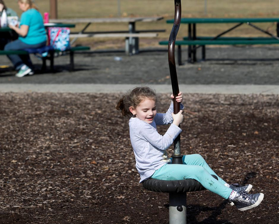 Madison Cifaldi, 4, of N. Branford, whirls around on a warm day at the Doolittle Park playscape in Wallingford, Tuesday, February 20, 2018. Dave Zajac, Record-Journal