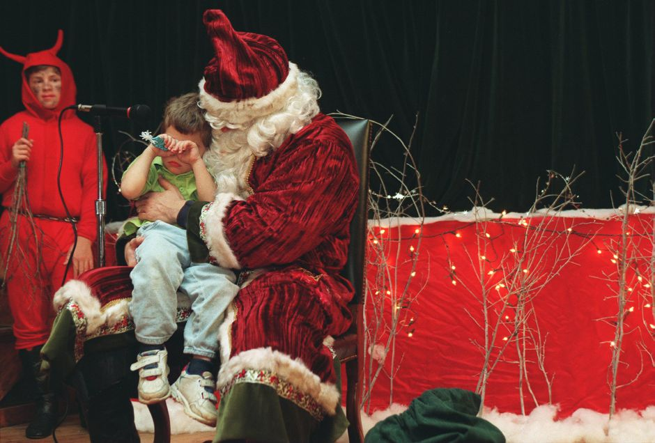 RJ file photo - Tyler Kovacs, 2, of Meriden, shows his bashful side when he meets St. Nicholas, a.k.a. Will Kovacs, during the Mikulas celebration at the Hungarian Community Club in Wallingford, Dec. 6, 1998. Tyler didn