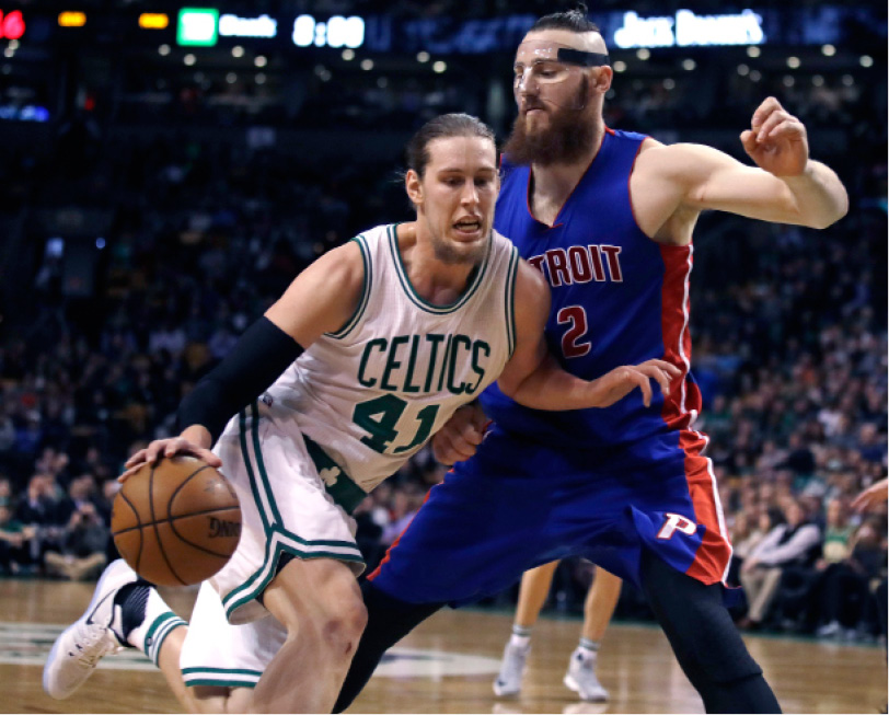 Boston Celtics center Kelly Olynyk (41) drives to the basket against Detroit Pistons center Aron Baynes (12) during the first quarter of an NBA basketball game in Boston, Wednesday, Nov. 30, 2016. (AP Photo/Charles Krupa)