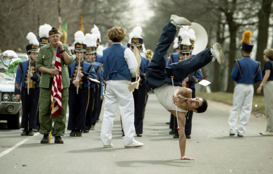 RJ file photo - Rob Rivera, a sophomore at Platt High School, practices flips along wit his baton twirling on Parker Avenue in Meriden shortly before the St. Patrick