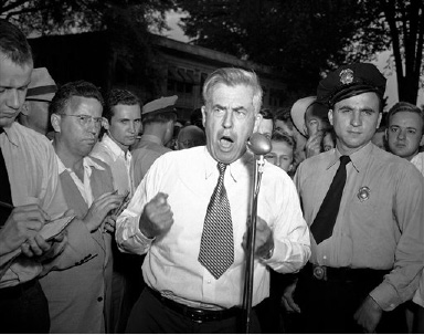 "Henry A. Wallace pleads for ""the right to have by say"" in a speech before a large crowd at Charlotte, N.C., Aug. 31, 1948. Boos and heckling drowned out most of the Progressive Party's presidential candidate's address, but he continued through to the end. Eggs and tomatoes were thrown but missed their mark. (AP Photo/Bill Chaplis)"