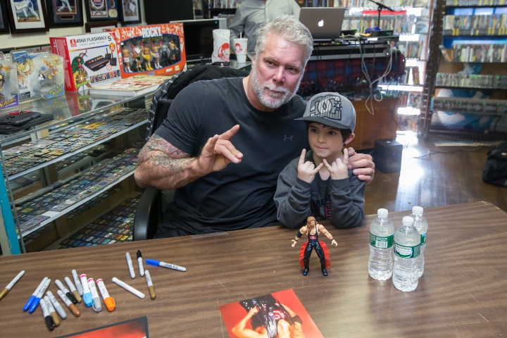 Pro wrestler Kevin Nash posses with Joey Langer 7 of Bristol for a photograph on  Saturday at M & J Video Game and First Base Collectables in Wallingford. | Justin Weekes / For the Record-Journal