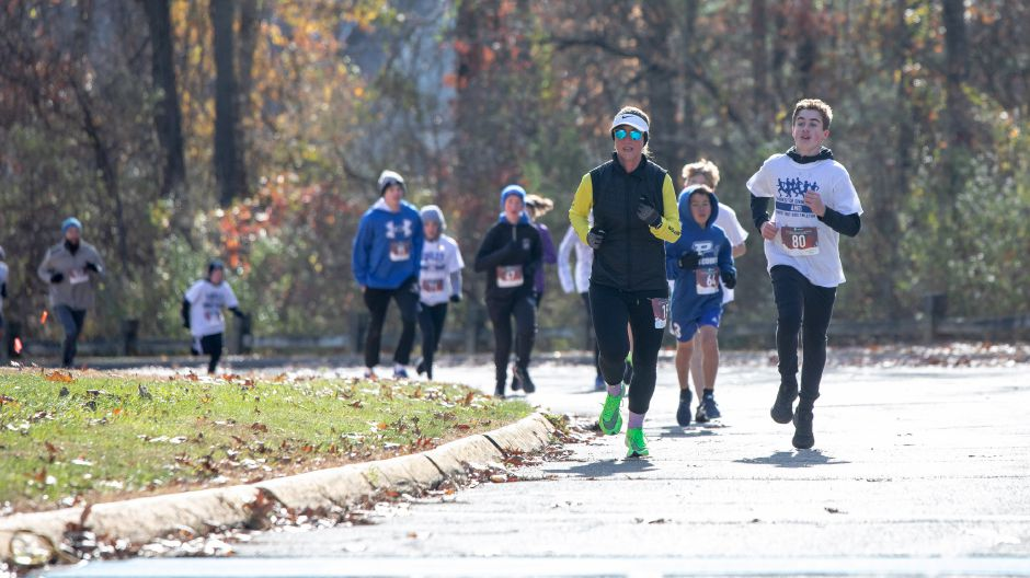 "Runners round the corner of the Middle School of Plainville bus loop in the ""Thanks for Giving"" road race on Oct. 9, 2019. The run raised around $7,000 — over half the money needed to fund the spring sports program at the school. 