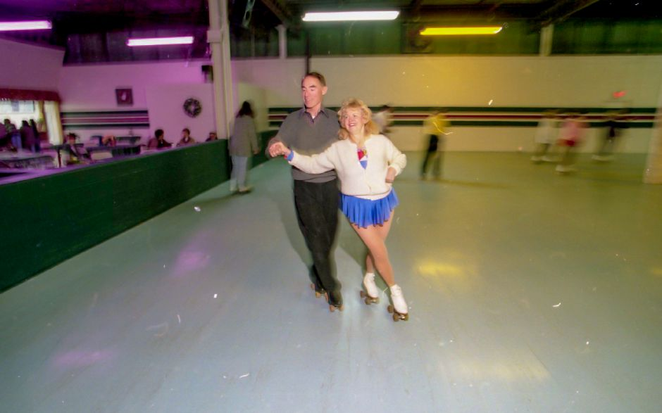 File photo - Nel Goguen, 57, of Windsor, and Bill Weber, 63, of Ridgefield, tear up the roller rink at Wheel World in Wallingford. The two used to skate together frequently several years ago and just happened to meet up again, Nov. 30, 1995.