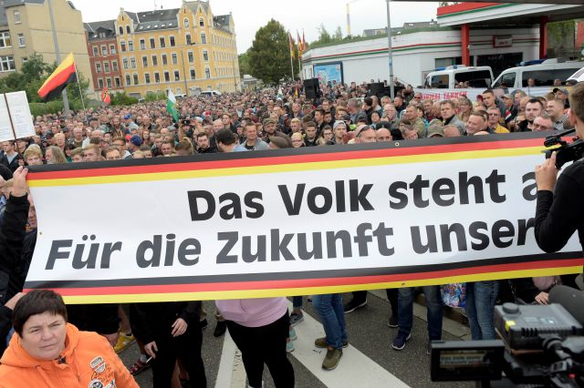 "People gather for a far-right demonstration in Chemnitz, Germany, Thursday, Aug. 30, 2018 after a man has died and two others were injured in an altercation between several people of ""various nationalities"" in the eastern German city of Chemnitz last Sunday. (AP Photo/Jens Meyer)"