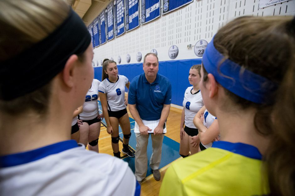 Southington head coach Rich Heitz speaks with players before facing RHAM Tuesday at Southington High School in Southington September 19, 2017 | Justin Weekes / For the Record-Journal