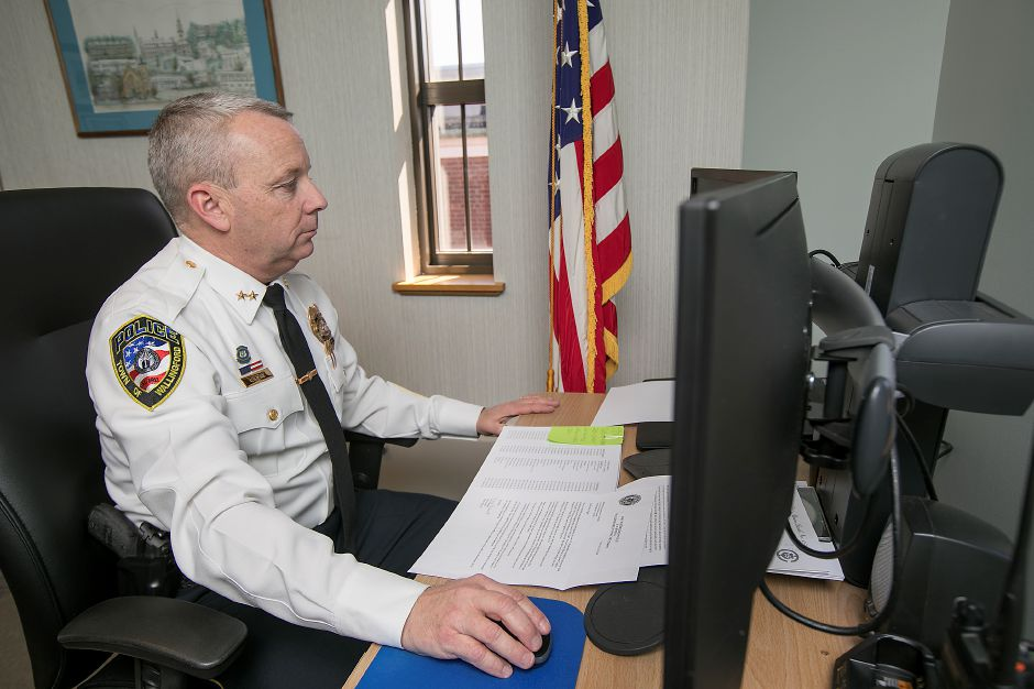 Police Chief William Wright at his desk at the Wallingford Police Department, Monday, March 26, 2018. Dave Zajac, Record-Journal