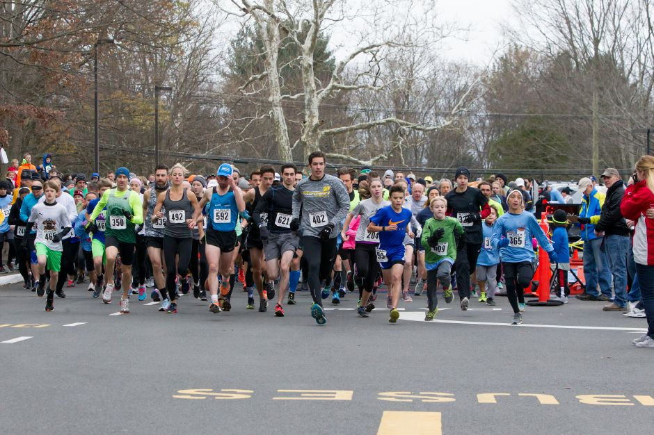 Runners leave the star Saturday during the Hot Coco 5K to benefit Abilities Without Boundaries at the Norton Elementary School in Cheshire November 18, 2017 | Justin Weekes / For the Record-Journal