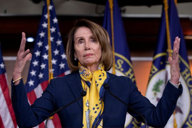 Speaker of the House Nancy Pelosi, D-Calif., talks to reporters a day after officially postponing President Donald Trump