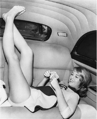"Jane Fonda, teenage daughter of actor Henry Fonda, apparently achieves solid comfort on plush interior of a car as she relaxes August 31,1959, between scenes of ""Tall Story."" The film is now in production in Hollywood and this will be Jane Fonda"