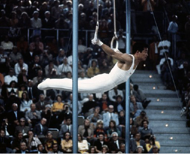 Akinori Nakayama of Japan earns his gold medal on the rings in the gymnastics division in the summer Olympics in Munich on Sept. 1, 1972. (AP Photo)