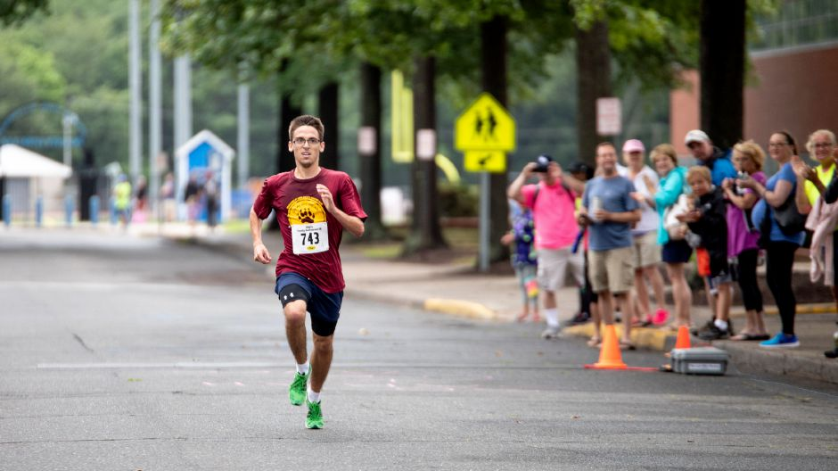Dean Yost, of Canton, closes in on the finish line of the Chip's Family Restaurant 5k Road Race. The Petit Family Foundation holds the race every year to raise money for the foundation