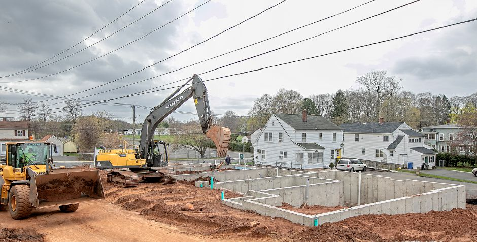 Crews begin work on the Eden and Main luxury townhomes off Eden Avenue in Southington, Fri., Apr. 19, 2019. The downtown development will total 64 residential units. Dave Zajac, Record-Journal