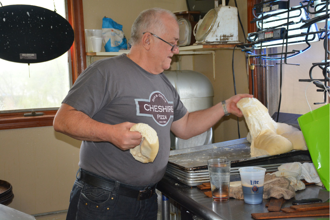 Minas Halkias of Cheshire Pizza getting the dough prepared and sectioned off for rolling. | Ariana D