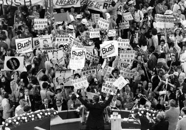 FILE - In this July 16, 1980 file photo George H.W. Bush, center foreground, acknowledges the crowd before speaking to the Republican Convention delegates in Detroit, Mich. Bush died at the age of 94 on Friday, Nov. 30, 2018, about eight months after the death of his wife, Barbara Bush. (AP Photo/File)