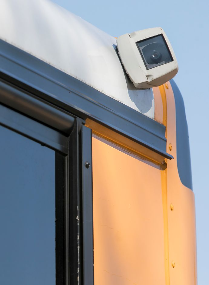 A camera, top right, mounted on the back corner of a school bus Wednesday at Lyman Hall High School in Wallingford.Dave Zajac, Record-Journal