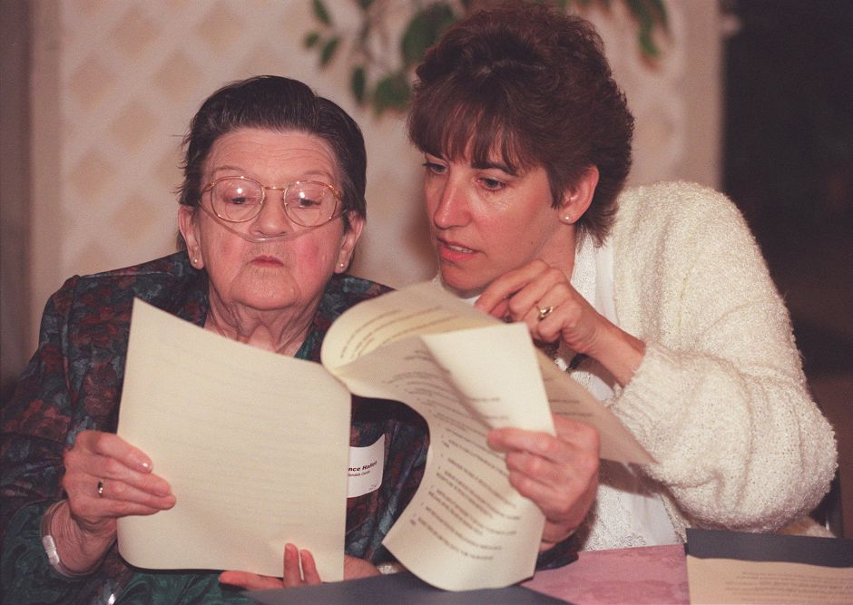 RJ file photo - Florence Hallett, a resident at Glendale Center in Naugatuck, and Lynn Kirdzik, a therapuetic recreation direction at Glendale, look over care reform proposals at the Aqua Turf Club during the statewide Voice Forum for nursing home residents Sept. 9, 1998.