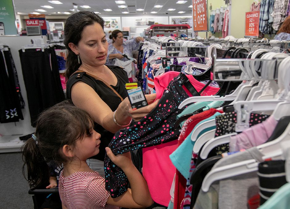 Paula Rosado, of Meriden, shops for clothes for daughter, Camila, 6, during tax-free week at Kohl