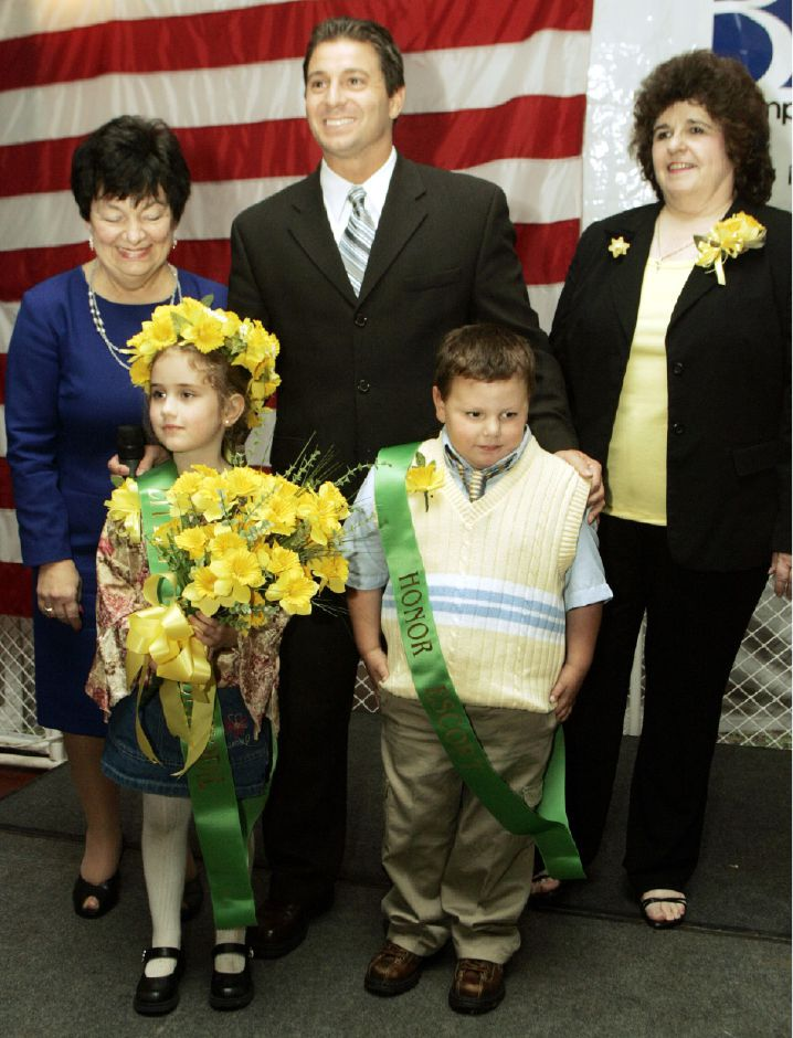 Little Miss Daffodil Mae Lancaster, of Hanover School, and her Honor Escort Daniel Barillaro, of Nathan Hale School, Wed. night, April 27, 2005 in Hubbard Park with City Clerk Irene Masse, left, Mayor Mark Benigni, center, and Doreen Roddy, right.