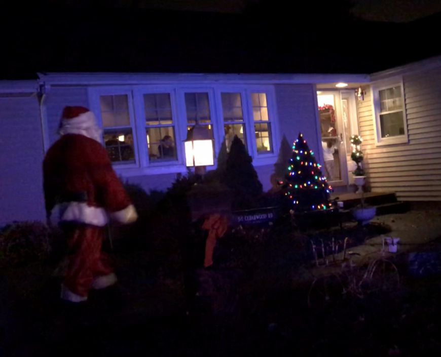Santa visits a home in Berlin as part of the Santa Express, Tuesday, Dec. 5. |Ashley Kus, The Citizen
