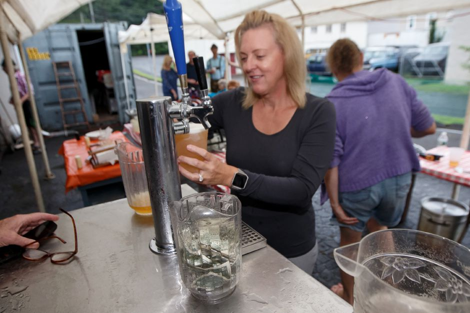 Heatir Fostyni pours a beer Saturday during Bierfest at the Meriden Turner Society in Meriden. The 152 year old Society celebrates German cultural, food, music and dancing.  August 11, 2018 | Justin Weekes / Special to the Record-Journal