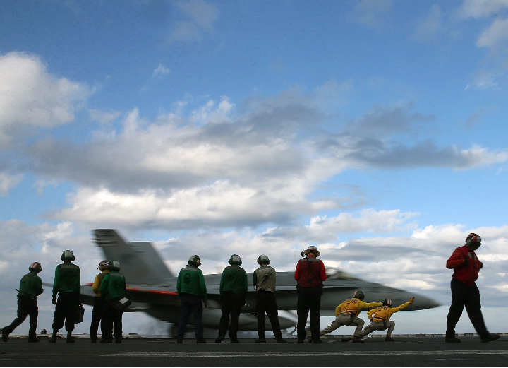 Flight deck crew members launch a F18 Super Hornet from the deck of the USS Eisenhower in the Atlantic Ocean off the coast of Virginia, Thursday, Dec. 10, 2015. U.S. Secretary Ash Carter visited the carrier with India