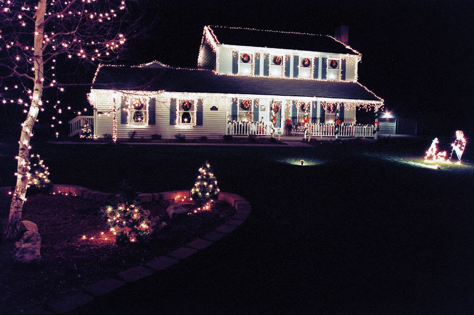 RJ file photo - This house on Strawberry Lane in Southington is covered with white lights for the holiday season, Dec. 1998.