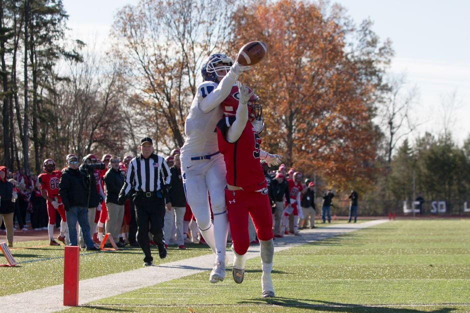 Cheshire defender Nick Quint plays tight on Southington receiver Timothy O