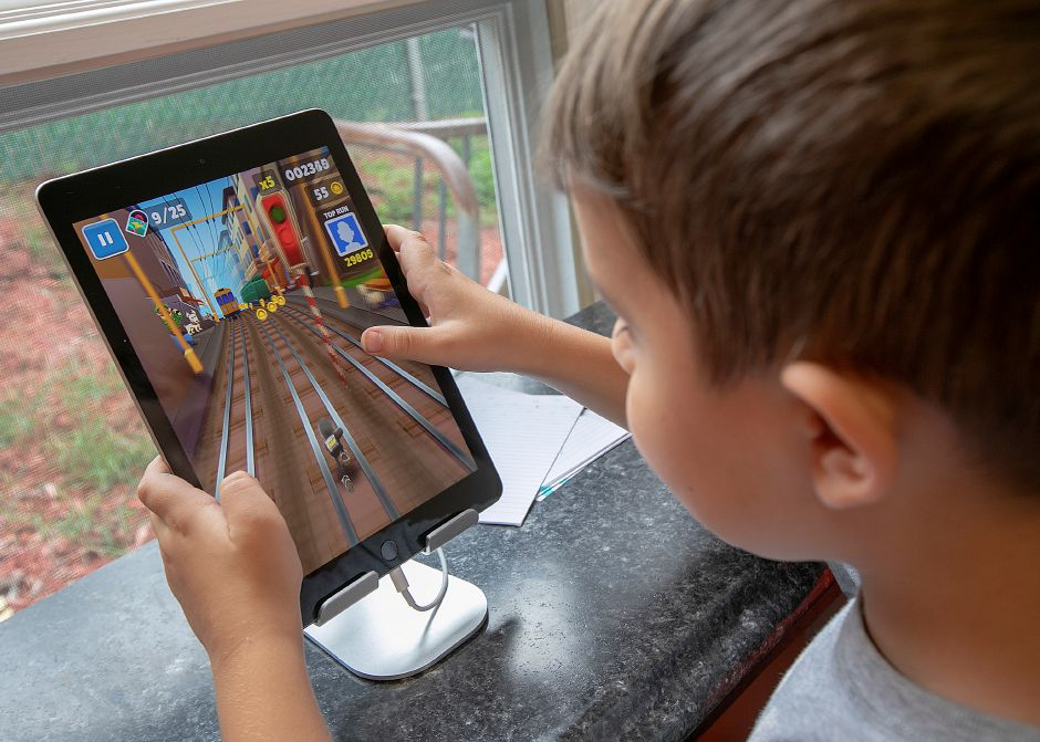 "Maxwell Rodriguez, 7, of Wallingford, plays the video game ""Subway Surfers"" in the new computer lab."