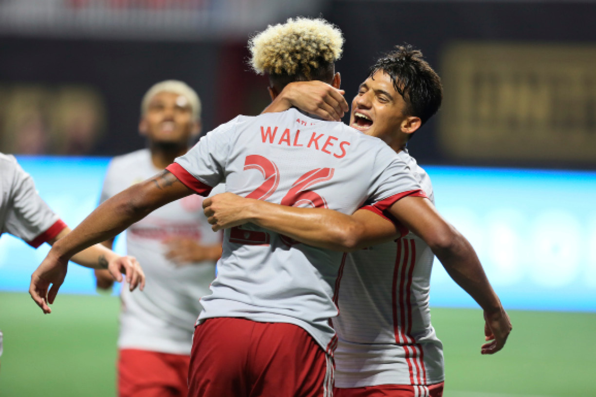 Atlanta United midfielder Yamil Azad embraces defender Anton Walkes (26), who scored against the New England Revolution during an MLS soccer match Wednesday, Sept. 13, 2017, in Atlanta. (Miguel Martinez/Atlanta Journal-Constitution via AP)