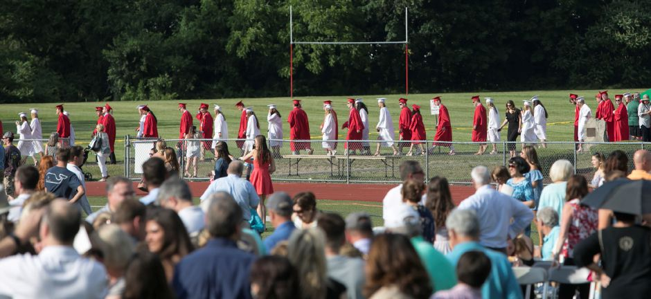 Graduates walk in procession to graduation ceremonies at Cheshire High School, Thursday, June 21, 2018. Dave Zajac, Record-Journal