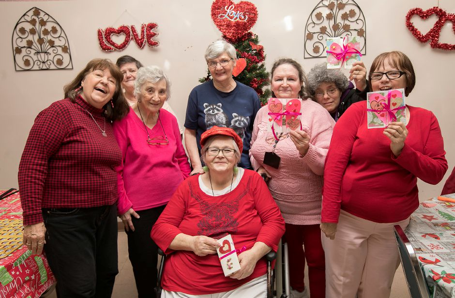 Seniors show a variety of handmade cards they created on Valentine