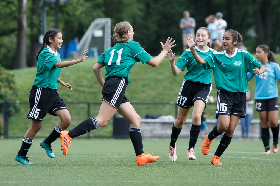 Wallingford Wolves Shelby Green (11) celebrates with teammates after scoring Monday during the annual TWIST soccer tournament at Choate Rosemary Hall in Wallingford August 20, 2018 | Justin Weekes / Special to the Record-Journal