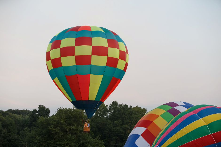 Hot Air Balloons take flight on launch day Saturday during the 34th Annual Plainville Balloon Festival at Norton Park in Plainville August 25, 2018 | Justin Weekes / Special to the Record-Journal