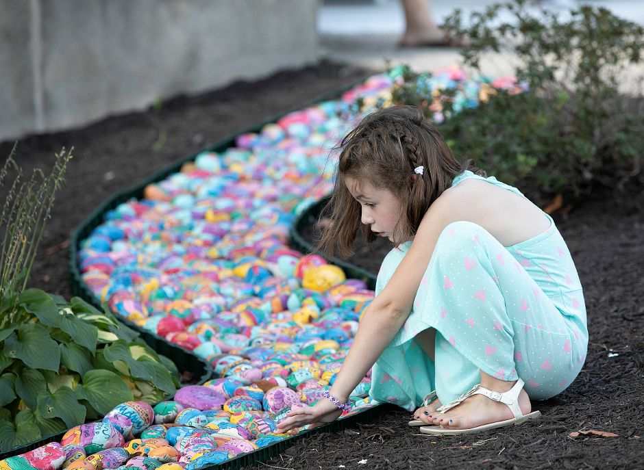 Charlotte Mooney, 5, explores a painted rock stream outside the school after her first day of kindergarten at Derynoski Elementary School in Southington, Thursday, August 30, 2018. Dave Zajac, Record-Journal